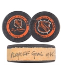 "Brett Hulls 1995-96 St. Louis Blues ""62nd Career Playoff Goal - Ties Dad Bobby Hull"" Goal Puck with His Signed LOA"
