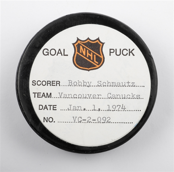 Bobby Schmautzs Vancouver Canucks January 1st 1974 Goal Puck from the NHL Goal Puck Program - 20th Goal of Season / Career Goal #87 of 271